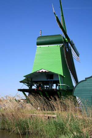 Famous picturesque Zaanse Schans in Netherlands. Group of historic old windmills .  Stock Photo - 4550844