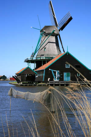 Famous picturesque Zaanse Schans in Netherlands. Group of historic old windmills .  Stock Photo - 4550843