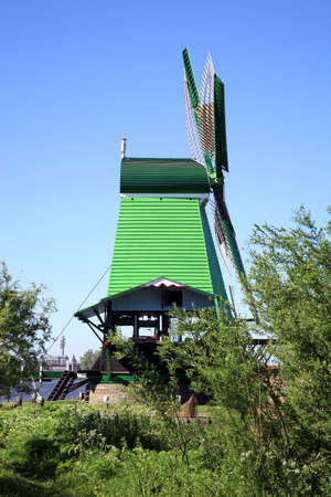 Famous picturesque Zaanse Schans in Netherlands. Group of historic old windmills .  Stock Photo - 4550846