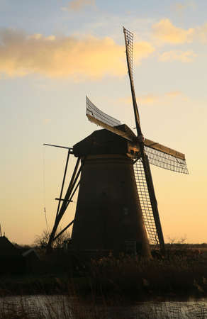 Traditional Dutch pumps by sunset photo