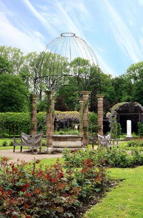 Openwork gazebo in the gardens of De Haar castle in the Netherlands photo