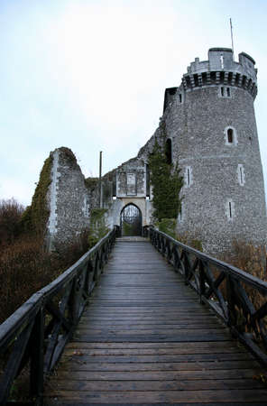 Old ruins of haunted castle. Gloomy day and dark clouds above castle. France. Standard-Bild