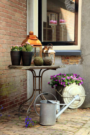 backstreet: Picturesque small garden in backstreet in Netherlands with still life Stock Photo