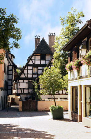 Narrow picturesque street in Petite-France with typical half-timbered building. Old Town in Strasbourg, Alsace, France.