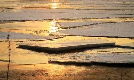 hacked: Wloclawek in Poland - sunset. Hacked off with ice the Vistula, ice floe on the river.