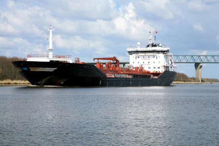 Oil tank. Ship with cargo on the Kiel Canal, Germany.  photo