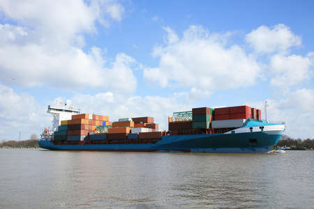 Container ship with cargo on the Kiel Canal, Germany.  版權商用圖片