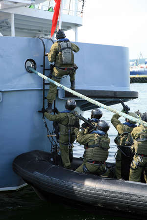 Soldiers marines ( sea commandos ) boarding a ship in a simulated assault. A Navy Soldiers boarding team member assigned to the  ship for the  to conduct a search of the vessel.
