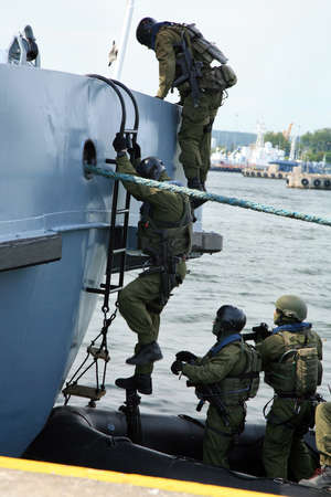 terror: Soldiers marines ( sea commandos ) boarding a ship in a simulated assault. A Navy Soldiers boarding team member assigned to the  ship for the  to conduct a search of the vessel.
