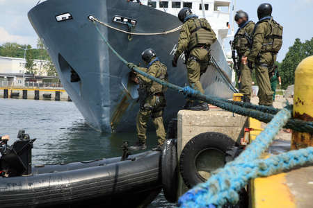 anti terrorist: Soldiers marines ( sea commandos ) boarding a ship in a simulated assault. A Navy Soldiers boarding team member assigned to the  ship for the  to conduct a search of the vessel.
