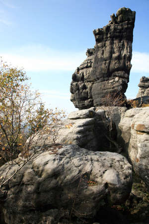scrambling: Phenomenon of nature – Stolowe ( Table ) Mountains – rock formations in National Park – Poland near Pasterka village. Stock Photo