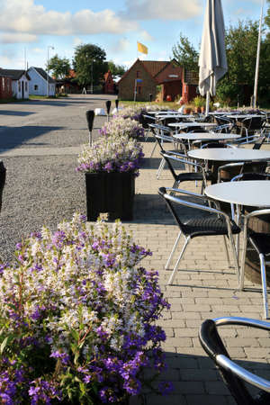 promenade: Danish traditional fish restaurant with smokehouse chimneys Snogebaek, Bornholm, Denmark, Europe