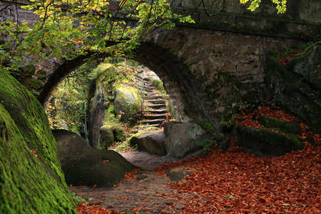 The secret garden landscaping  Old stone bridge and stairs Stock Photo