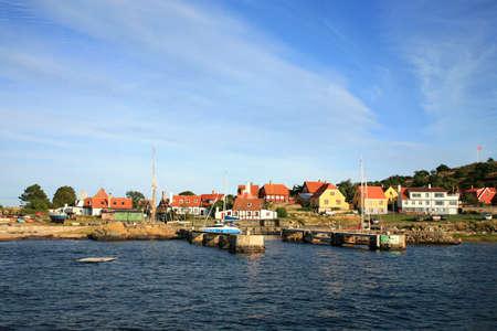 Gudhjem malerische, kleine Stadt bei Sonnenuntergang auf der Insel Bornholm, Dänemark, Europa