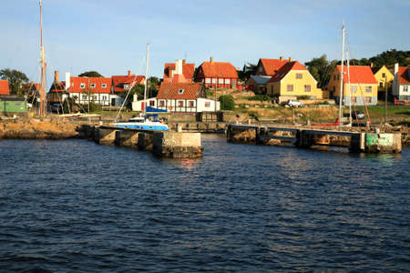 Gudhjem picturesque, small town by sunset on Bornholm Island, Denmark, Europe photo