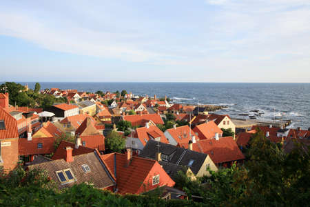 Panorama of picturesque small town Gudhjem with red roofs by early morning, Bornholm Island, Denmark photo