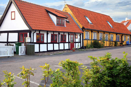 Typical timber framing colorful old house in Gudhjem, Bornholm Island, Denmark