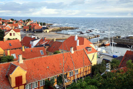 Storm on the sea, picturesque small town Gudhjem by early morning, Bornholm Island, Denmark