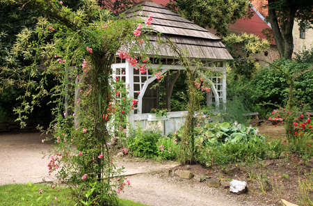 A gazebo in the garden with climbing roses  Palace Formal Garden, Czech Republic, Ratiborice, Grandmother's Valley  photo