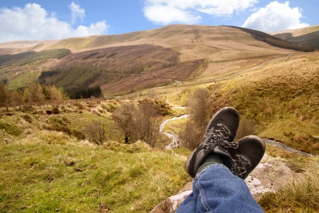 lying forward: resting after hiking up side of welsh mountain