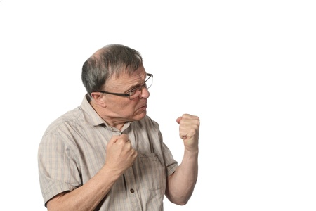 insulting: angry man with clenched fists white background Stock Photo