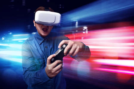 exciting: Man playing video games wearing vr headset