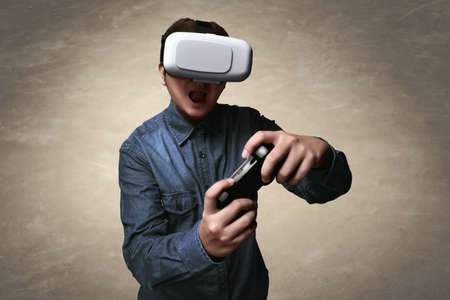 move controller: Man playing video games wearing vr headset
