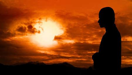 trust god: Silhouette of muslim man praying