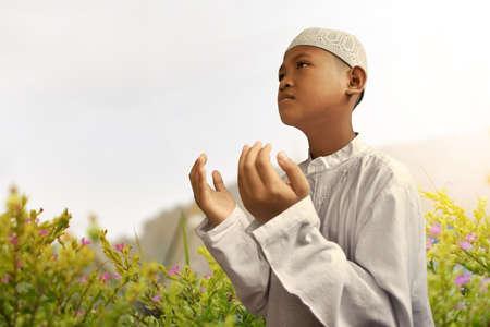 trust god: Asian muslim kid praying
