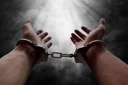 Hands of prisoner in handcuffs