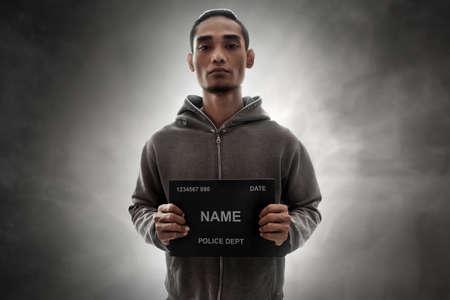 Mugshot of criminal Stock Photo