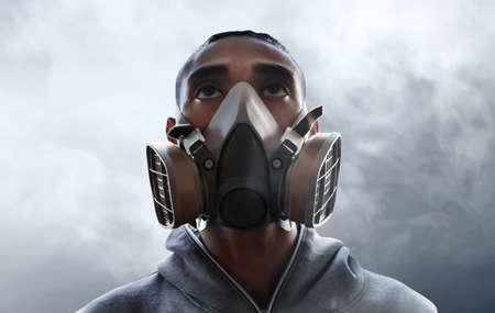 Man wearing respirator mask Stock Photo