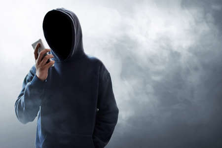Hacker using mobile phone