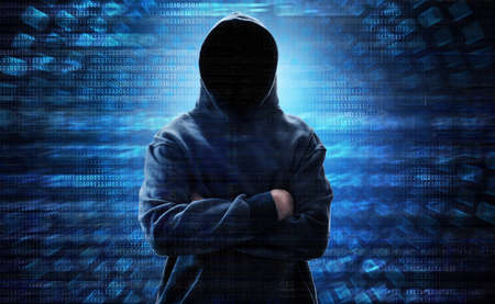 Hooded computer hacker Stock Photo