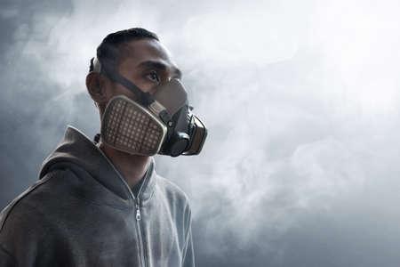 Graffiti artist wearing a gas mask Stock Photo