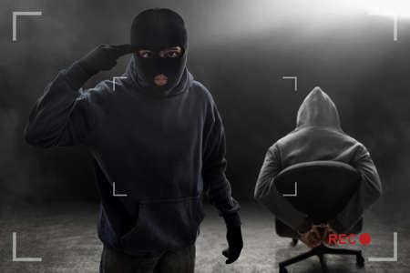 Masked thief threatening