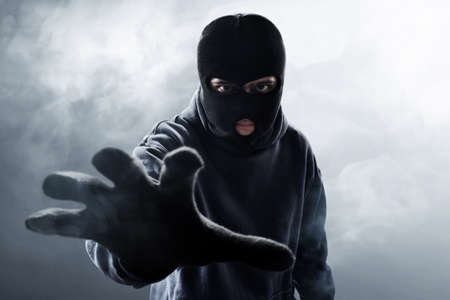 Thief in balaclava Stock Photo