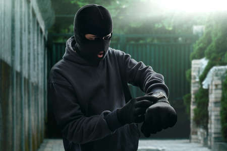 Masked thief waiting Stock Photo