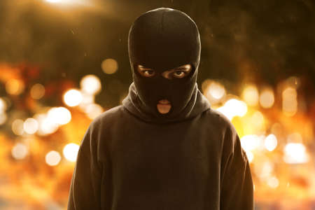 Terrorist wearing a mask Stock Photo