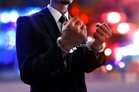 Businessman in handcuffs Stock Photo