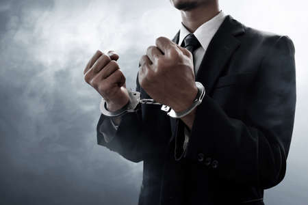 Businessman in handcuffs Archivio Fotografico