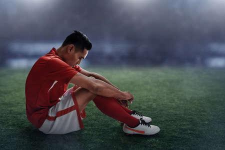 Soccer player lose Stockfoto