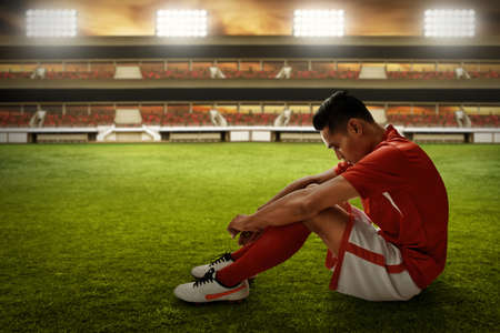 Soccer player lose concept photo Stockfoto