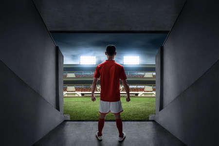 Soccer player standing on stadium entrance Archivio Fotografico