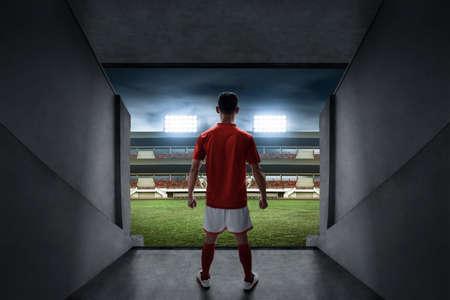 Soccer player standing on stadium entrance Zdjęcie Seryjne