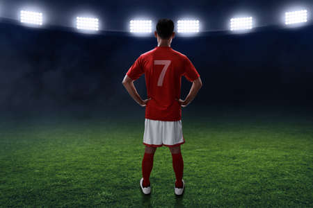 Soccer player standing on the field