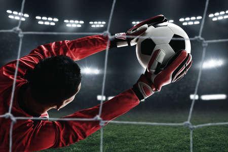 Soccer goalkeeper catches the ball