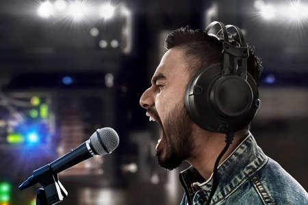 Singer recording a song