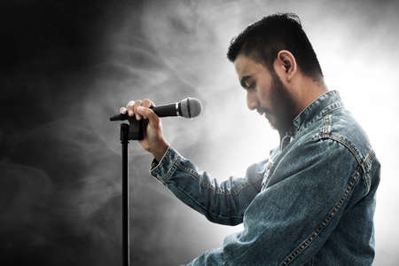 Singer holding microphone