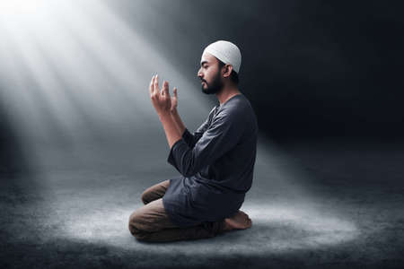 Religious asian muslim man praying